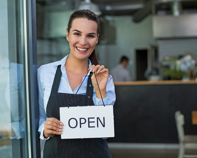 cafe owner with open sign